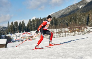 Dolomitenlauf 2015, 18.01.2015, Lienz, Austria (AUT): slower racers with stadium in the background- FIS Marathon Cup Dolomitenlauf, Lienz (AUT). www.nordicfocus.com. © Felgenhauer/NordicFocus. Every downloaded picture i